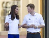 .Catherine, Duchess of Cambridge aka Kate Middleton and Prince Harry Prince William, Duke of Cambridge and Catherine, Duchess of Cambridge aka Kate Middleton and Prince Harry welcome the Olympic Flame to Buckingham Palace during the Olympic Torch Relay London, England