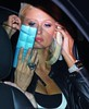 Paris Hilton checks how she looks before arriving for 'Repo! The Genetic Opera' event at Stingaree nightclub San Diego, California