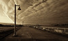 Waterfront Walkway, Tacoma [Explore] (tacoma290) Tags: lines sepia clouds fence lights nikon perspective walkway pacificnorthwest tacoma lightpoles pnw piliings walkwaytacoma pilingsfordonbriggs explore02aug12