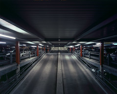 Car park (needler_) Tags: longexposure film horizontal architecture switzerland fuji geneva parking wideangle nobody 4x5 carpark architects e6 p2 sinar p51 artificiallight 75mm astia100f gva lsgg cointrin 80a tetenal rapf genevainternationalairport sinaronw freistefani