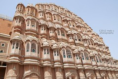 Hawa Mahal, Palace of Winds, Jaipur (Malc ) Tags: old city travel pink red india building art tourism window stone wall architecture facade asian photo ancient sandstone asia photos indian muslim islam traditional mahal prince landmark palace front queen arabic empire stockphotos wife getty historical sultan pushkar winds legacy harem jaipur magnificent polygamy rajasthan royalpalace hawamahal citypalace gettyimages solid stockphoto hawa pinkcity stockphotography mughal maharajah zenana rajput latticework photosof maharani palaceofwinds wwwgettyimagescom polygyny maharajasawaipratapsingh  lalchandustad palaceofthebreeze wwwgettyimagescouk