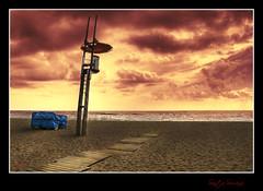 Esperando mejores tiempos (Ramirez de Gea) Tags: sunset costa landscape atardecer playa arena hdr vigilancia hamacas santasusana flickrestrellas spiritofphotography hdraward nikonflickraward oltusfotos goldenawardlostcontperdidos