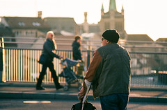 magic hour rest () Tags: sunset people sunlight slr film yellow 35mm switzerland afternoon pentax sunny oldman lausanne resting crutches magichour supera