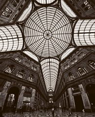 Accordion player (travelben) Tags: street roof bw italy abstract building glass lines metal architecture 1 europa italia gallery graphic geometry steel eu samsung structure nb ceiling fisheye dome napoli naples ribbed umberto italie galleria