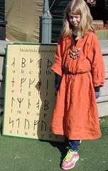 Rune girl (bokage) Tags: girl child sweden stockholm script rune kungstrdgrden medievalmarket bokage