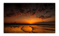 The Final Glimmer   [Explored] (RonnieLMills) Tags: county ireland sun landscape nikon angle harbour tide low wide down explore northern setting tamron donaghadee 1024 482 autofocus d90 explored 12516 daarklands pastfeaturedwinner