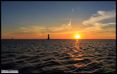 Sunset at FrankFort Michigan Harbor Lighthouse (Chinmay Avachat Photography) Tags: camera sunset people copyright usa lake art water beautiful mi composition america port canon lens landscape island photography rebel harbor us flickr moments cloudy outdoor michigan unitedstatesofamerica detroit creative scenic surreal sunny commons lookout best potd na explore cap american shore northamerica dslr pictureoftheday arcadia allrightsreserved clearwater frankfort photooftheday picoftheday scenichighway m22 700d flickriver t5i 1855stm chinmayavachatphotography