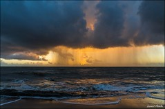 Hesitation, sun or rain today? (Laurent Asselin) Tags: sun mer rain clouds sunrise soleil colours lumire couleurs pluie ciel nuages paysage aube ocan