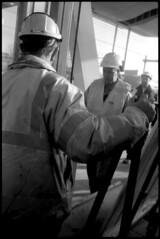 Arnhem Centraal Station (Pim Geerts) Tags: street trip bw white black film monochrome station analog photography workers zwartwit ns arnhem rangefinder olympus hp5 worker 35 ilford helm spoor centraal spoorwegen nederlandse analoog bouwvakkers werkers straatfotografie meetzoeker straatplaat
