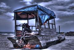 Wrecked (HunggNguyen) Tags: sky sunlight reflection sunrise island bay boat long ship cloudy coto vietnam waters rays ha wreck hdr quang ninh hunggnguyen