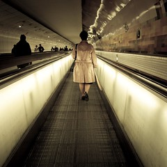 Montparnasse (Gilderic Photography) Tags: light people urban woman cinema paris france metal dark underground subway square lumix lights moving movement europe raw mood metro femme escalator perspective tunnel panasonic story sombre cinematic montparnasse mecanique mouvement lightroom carre 500x500 gilderic lx3 dmclx3