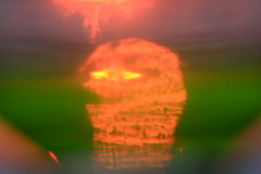 Variations on a sunset #4: Pacman sunset (kevin dooley) Tags: sunset summer vacation orange sun lake distortion water glass yellow canon lakemichigan pacman variations variation detergent distort newbuffalo cuo 40d variationsonasunset pacmansunset