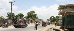 On the Road - Cap-Hatien, Haiti (Alex E. Proimos) Tags: poverty haiti fight support country international aid cap trucks economic development survival struggle developing haitien caphatien