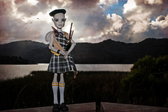 piper at the gates of dusk (pukunui81) Tags: longexposure lake clouds canon landscape toy doll kilt cam dramatic scottish gargoyle highland bagpipes tartan 550d t2i canoneos550d createamonster monsterhigh flintmacquarrie