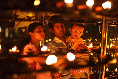 Oil lamps (Dexter Cruez) Tags: family srilanka kandy templeofthetooth oillamps worshippers lightingoillamps
