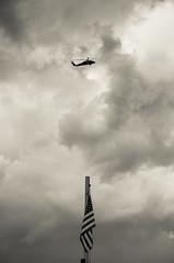 Helicoptor flying over USS Intrepid (John Fn Photography) Tags: sky usa cloud newyork america moody unitedstates flag unitedstatesofamerica northamerica newyorkstate splittone usofa helicoptor stateofnewyork intrepidseaairandspacemuseum