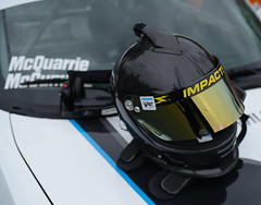 HANS and helmet ready to race at Lime Rock Park (albionphoto) Tags: usa hans ct continental camaro porsche cayman corvette astonmartin reddragon gridgirls lakeville daytonaprototype ganassi