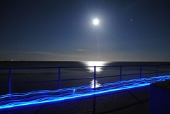 Passing Blue (mnika4) Tags: ocean blue light sea sky moon lightpainting colour beach stars lymeregis lyme