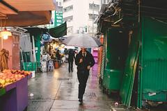 Rushing (par_amour) Tags: ifttt 500px hong kong wan chai street urban city market man umbrella rain running colour sony sigma hidden