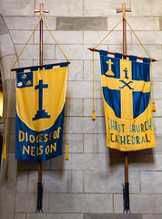 The Blue and Yellow Church Banners (Steve Taylor (Photography)) Tags: blue newzealand christchurch brown art church lines yellow stone wall architecture grey star design cross cathedral flag banner nelson rope pole nz southisland ix tassel diocese angican