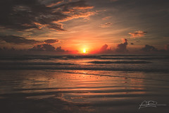 Red Sunrise (AmaurieRaz) Tags: morning light red sun detail beach nature clouds sunrise canon photography sand post florida east daytonabeach 1740mm 60d