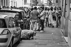 Alone In A Crowd (Culture Shlock) Tags: street people italy florence alone crowd poor sidewalk begging beg panhandle disenfranchised panhandling