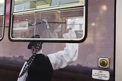 (Giovanni Stimolo) Tags: street city woman man reflection window glass colors girl reflections advertising photography lights glasses back eyecontact fuji arm streetphotography streetportrait tram whip behind streetreportage x100s fujifilmfinepixx100s