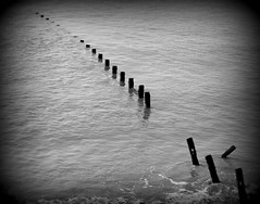Out at Sea (Tony Worrall Foto) Tags: wood uk sea wild england broken wet water wooden seaside waves break northwest decay scene lancashire line resort barrier poles rotten posts seashore blackpool lancs fylde abandonnded 2012tonyworrall