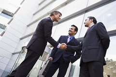 Business people shaking hands outside office (Smith413) Tags: city people man building male horizontal standing outside office team commerce group meeting corporation business international staff handshake worker colleagues block discussion talking manager chatting trade success greeting forties confident 40s ethnicity middleeastern confidence teamwork 20s welcoming businessmen caucasian businesspeople interracial twenties shakinghands successful middleaged discussing threepeople