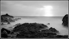 Baie d'Ecalgrain (2) (Lucien Vatynan) Tags: longexposure sea blackandwhite mer white black beach noir noiretblanc stones olympus normandie normandy plage blanc manche rochers roche cotentin ecalgrain poselongue baiedecalgrain epl1
