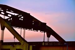 Bridge (Marina K Caprara) Tags: city bridge pink blue sunset urban yellow night evening pretty pittsburgh steel bridges blackandyellow