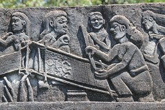 Ikat weaving with an ancestor, grave stone,  Umabara, Melolo, Sumba Timur (Sekitar) Tags: sculpture art grave stone rural indonesia relief ancestor remote weaving pulau timur ntt ikat sumba kuburan earthasia umabara melolo