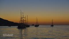 Barche in rada a Stromboli (Andrea Rapisarda) Tags: travel sunset sea italy seascape tourism landscape boats nikon italia tramonto mare pano silhouettes location barche panoramica sicily fotografia 169 turismo sicilia eolie aeolianislands d800 velieri 2470mmf28 imbarcazioni