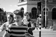 Childwood (luisfmgoncalves) Tags: street netherlands amsterdam kids 35mm fun lights nikon crossing running stop 18 d5100