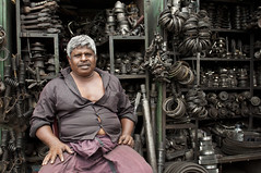 The cog man. (Photosightfaces) Tags: man shop sri lanka springs oily cog seller colombo srilankan trader maradana