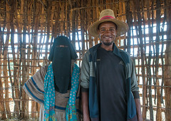 Muslim couple in their house, Kembata, Alaba kuito, Ethiopia (Eric Lafforgue) Tags: poverty africa portrait people woman house man color home hat horizontal architecture religious outdoors clothing women couple village veil muslim islam traditional religion culture hidden hut covered wife housing tradition ethiopia niqab ethnic residential 2people twopeople adultsonly hornofafrica riftvalley eastafrica abyssinia lookingatcamera ruralscene waistup alaba toukoul tukul halaba kembata kulito alabakuito ethio163362