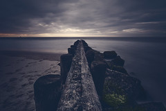 A Fine Line (DJawZ) Tags: ocean longexposure morning sea beach water clouds island dawn long exposure jetty atlantic gloom