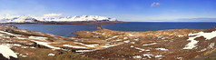 with space comes time ... (lunaryuna) Tags: houses light sky panorama snow ice season landscape coast iceland spring solitude colours textures silence fjord isolation blueskies lunaryuna mountainrange northatlantic siglufjordur panoramicviews northiceland seasonalchange northfjords seasonalwonders