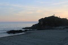 posing or proposing (nald_babaran) Tags: blue boy sunset sea orange beach girl silhouette pose sand scenery rocks resort tamron