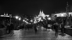 Night's Bridge (McQuaide Photography) Tags: old city longexposure nightphotography travel light blackandwhite bw building castle history tourism lamp monochrome architecture night zeiss outside mono blackwhite streetlight europe prague outdoor widescreen sony tripod gothic praha landmark panoramic historic 55mm czechrepublic lantern fullframe alpha 169 charlesbridge oldbuilding touristattraction praag lessertown manfrotto c1 gothicarchitecture czechia centraleurope sonnar karlvmost malstrana capitalcity primelens eskrepublika captureone mirrorless sony55mmf18 mcquaidephotography a7rii ilce7rm2 captureonepro9