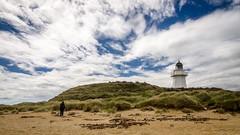 Waipapa Point lighthouse (Kathrin & Stefan) Tags: ocean newzealand sky cloud lighthouse building beach nature sand outdoor southisland tasmansea headland waipapapoint fortrose foveauxstrait kathrinmarks waipapapointlighthouse