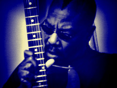 The Blues Guitarist (raymondclarkeimages) Tags: blue portrait people music usa color amazing rockstar guitar sony awesome cybershot mohawk strings grainy effect guitarist guitarplayer fretboard frets raymondclarkeimages 8one8studios