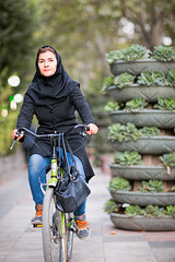 Female cyclist in Tehran (damonlynch) Tags: park people woman plants tree green nature girl bike bicycle gardens female scarf walking landscape religious person bicycling cycling persian clothing women scenery adult iran landscaping pavement walk feminine muslim islam religion headscarf transport middleeast hijab places clothes sidewalk elderly cycle transportation land aged iranian tehran adults footpath humans citypark municipalpark middleeastern humanbeings womensclothing dominantcolor dominantcolour landtransportation lalehpark
