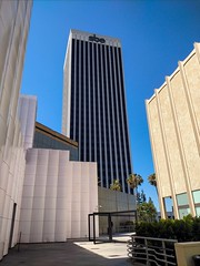 5900 Wilshire Boulevard (Thad Zajdowicz) Tags: building architecture sbe buildingcomplex skyscraper outdoor urban city lacma losangelescountymuseumofart 5900wilshireboulevard losangeles california zajdowicz lines geometry sky color blue colour cellphone motorola droid turbo shapes angles geometric android mobile photoshopexpress outside 366 365 smartphone cameraphone windows walls palmtrees daylight availablelight sign letters