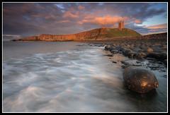 Standing Alone (greyridge) Tags: sunset seascape castle boulders northumberland dunstanburgh dolerite