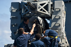 Fire controlmen perform maintenance on a close-in weapon system. (Official U.S. Navy Imagery) Tags: japan sailors usnavy ras cruiser underway guidedmissilecruiser usscowpens eastchinasea 7thfleet unrep vertrep flightoperations forwarddeployed usscowpenscg63