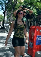 free news (omoo) Tags: newyorkcity girl couple westvillage streetscene prettygirl greenwichvillage beautifulgirl freenews thevillagevoice freenewspaper barrowstreet narrowsidewalk redframedsunglasses rednewspaperbox