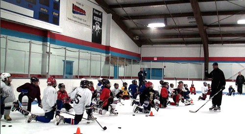 Brad Perry coaching a hockey school in Chicago  7