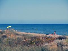 The yellow umbrella (Lolo_) Tags: sea people mer beach umbrella corse corsica parasol plage gens 2012 bastia méditerranée marana ombrelle