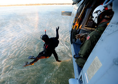 A Sailor jumps from an MH-60S during SAR training. (Official U.S. Navy Imagery) Tags: usa heritage america liberty freedom commerce unitedstates military navy sailors fast worldwide va portsmouth tradition usnavy protect deployed flexible onwatch beready defendfreedom warfighters nmcs chinfo sealanes warfighting preservepeace deteraggression operateforward warfightingfirst navymediacontentservice